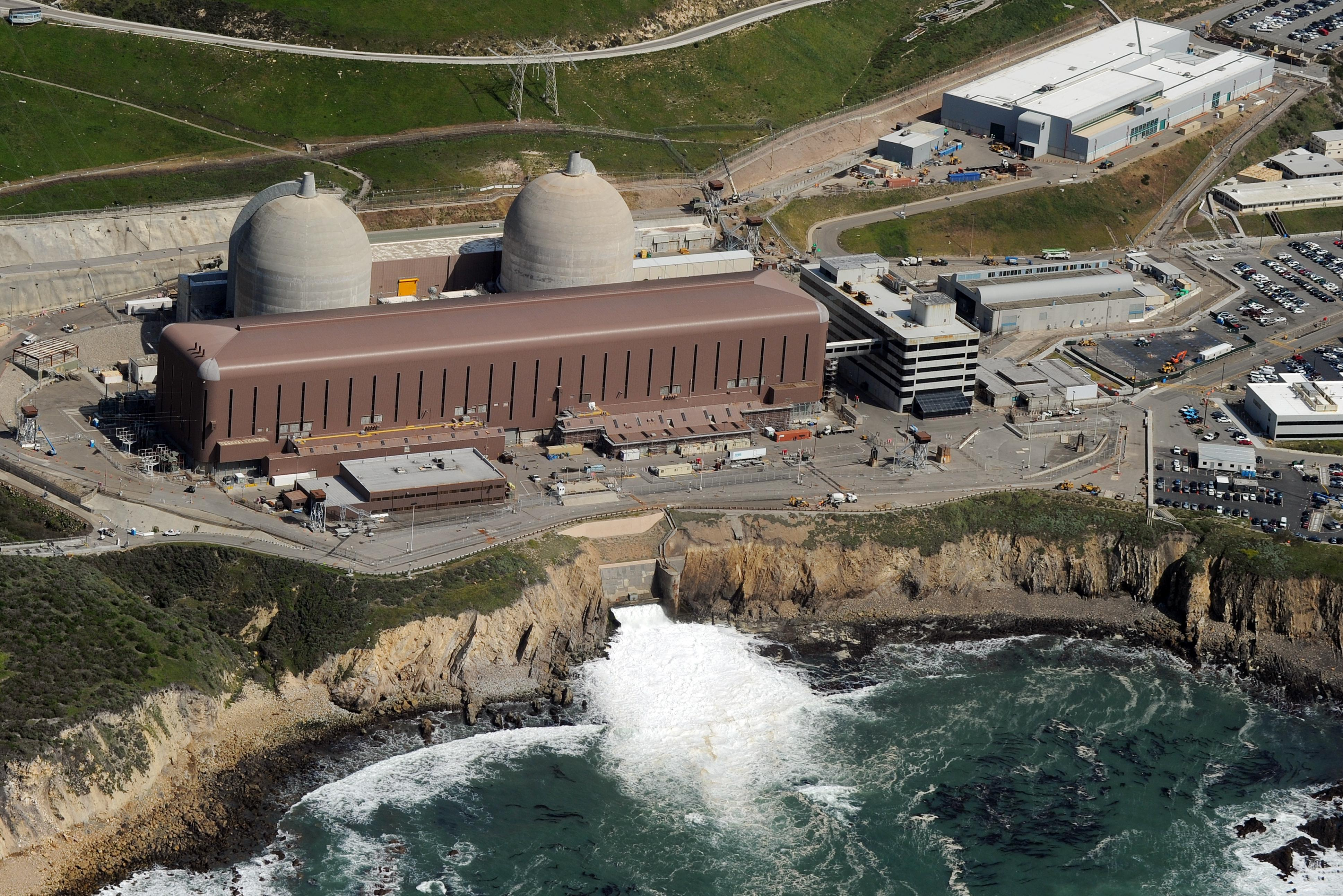 Aerial view of the Diablo Canyon Nuclear Power Plant which sits on the edge of the Pacific Ocean at Avila Beach in San Luis Obispo County, California on March 17, 2011.  Some of America's nuclear power plants loom near big city populations, or perch perilously close to earthquake fault lines. Others have aged past their expiration dates but keep churning anyway. President Barack Obama has demanded that the 104 nuclear reactors at 65 sites get a second look as scientists warn that current regulatory standards don't protect the US public from the kind of atomic fallout facing quake-hit Japan.                   AFP PHOTO/Mark RALSTON (Photo credit should read MARK RALSTON/AFP/Getty Images)